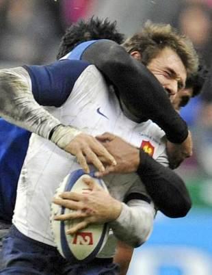 France's Vincent Clerc is tackled by Samoa's Misioka Timoteo, France v Samoa, Stade de France, Paris, France, November 21, 2009
