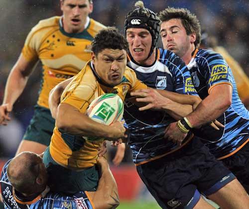 Australia's Tyrone Smith takes on Blues' defence