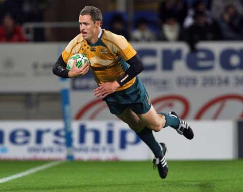 Australia's Luke Morahan dives over to score a try