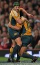Australia's Matt Giteau congratulates Tatafu Polota-Nau on a try