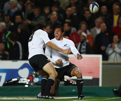 Mils Muliaina celebrates after touching down for the All Blacks