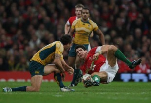 Wales fullback James Hook is levelled by Quade Cooper