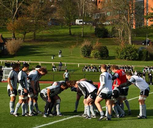 Schoolchildren watch as the All Blacks work on their scrummaging