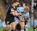 Leicester's Lewis Moody is tackled by the Wasps defence