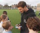 Glasgow Warriors scrum-half Chris Cusiter signs autographs