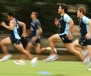 Daniel Halangahu runs with his Waratahs team-mates during training in Sydney