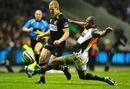 Quins Ugo Monye slides in to tackle Wasps' Dave Walder