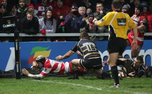 Gloucester lock Dave Attwood dives in to score a late try