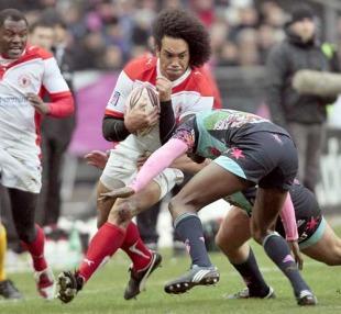 Biarritz's Samiu Vahafolau is tackled by Stade Francais' Djibril Camara