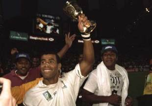 Fiji's talismanic captain Waisale Serevi lifts the Melrose Cup after his side defeated South Africa in the final of the World Cup Sevens, Fiji v South Africa, World Cup Sevens, Hong Kong Stadium, March 23 1997.