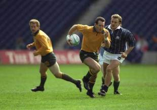 David Campese runs with the ball