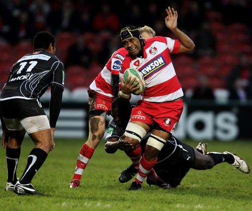 Gloucester's Akapusi Qera tried to evade a tackler