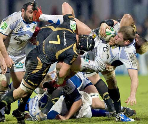 The Ospreys' defence gang up on Clermont's Elvis Vermeulen