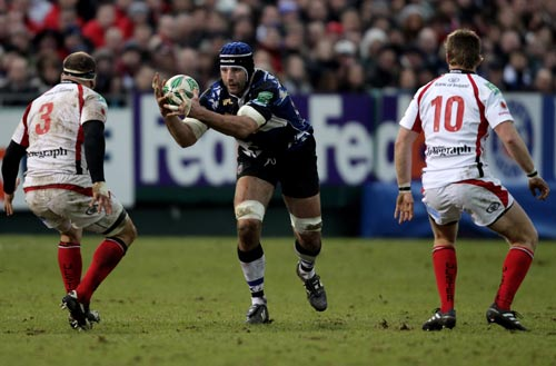 Bath's Danny Grewcock takes on the Ulster defence