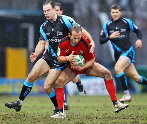 Sale's Charlie Hodgson tackles Toulouse's Frederic Michalak
