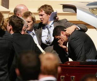 Patrick Phibbs, Stephen Hoiles and Morgan Turinui console each other at the funeral of Shawn Mackay, Mary Immaculate Church, Waverley, Sydney, Australia, April 15, 2009