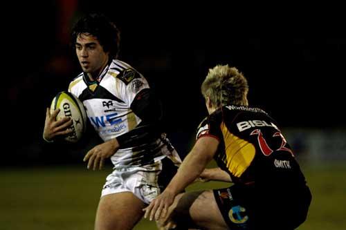 Ospreys fly-half Gareth Owen takes on Ashley Smith