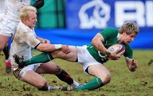 England Saxons fly-half Shane Geraghty tackles Ireland A's Fionn Carr