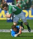 Ireland's Brian O'Driscoll evades italy's Ezio Galon