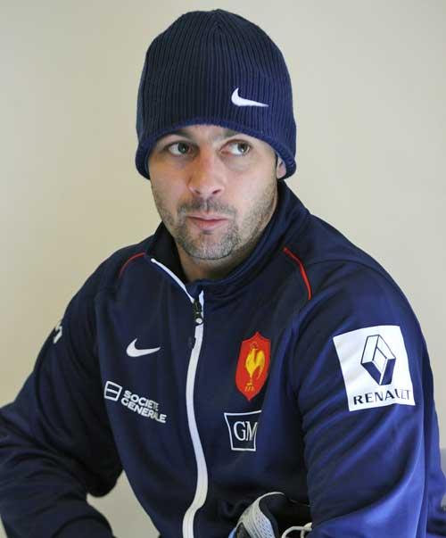 France's Jean-Baptiste Elissalde talks to the media