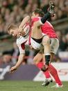 Wales' Gavin Henson tackles England's Mathew Tait
