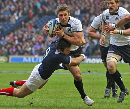 Scotland's Chris Cusiter is tackled by France's Morgan Parra