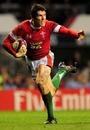 Wales centre James Hook breaks clear to score