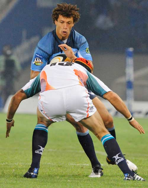The Bulls' Zane Kirchner is tackled by the Cheetahs' Corne Uys