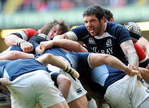 Scotland lock Jim Hamilton drags a rolling maul forward