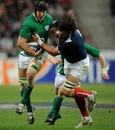 Ireland's Stephen Ferris breaks a tackle