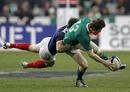 Ireland's Brian O'Driscoll loses control of the ball