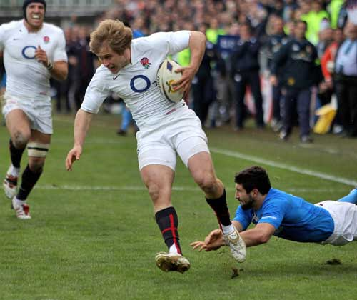 England's Mathew Tait races in to score a try