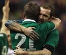 Ireland fullback Geordan Murphy embraces Ronan O'Gara following their victory over England