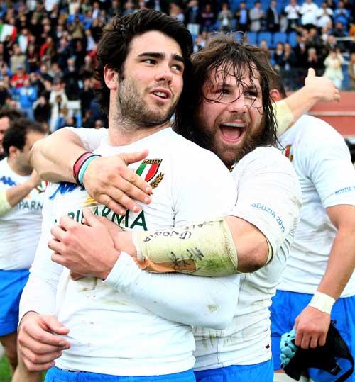 Italy's Luke McLean and Martin Castrogiovanni celebrate victory over Scotland