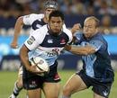 Waratahs hooker Tatafu Polota-Nau breaks past Gary Botha