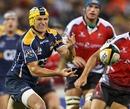 Brumbies fly-half Matt Giteau passes the ball