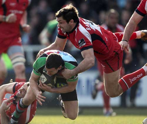 Harlequins' Karl Dickson is tackled by Worcester's Pat Sanderson