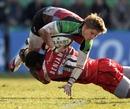 Harlequins' David Strettle is tackled by Worcester's Miles Benjamin