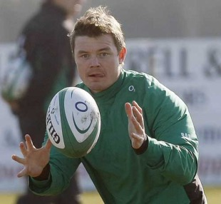 Ireland centre Brian O'Driscoll keeps his eyes on the ball during training in Greystones, County Wicklow, March 9, 2010